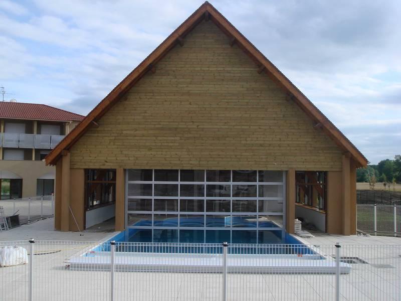 Porte sectionnelle vitrée pour séparation intérieur/extérieur dans résidence